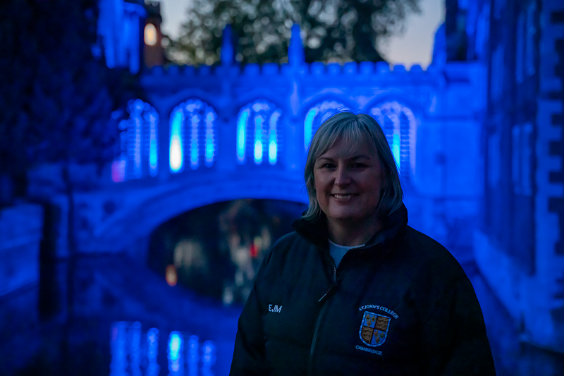 Emma Manuel, College Nurse, in front of the Bridge of Sighs, lit up in blue for the  NHS