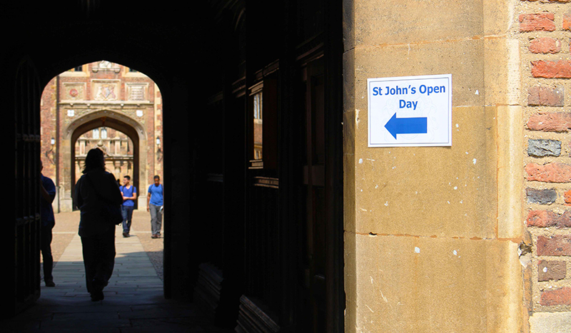 A corridor in St John's, with a sign pointing to the Open Day