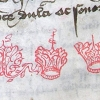 two crowns and a branch sketched in red