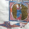 initial C showing Christ pointing to the sun, moon and stars