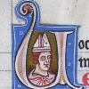 initial U incorporating the bust of a bishop