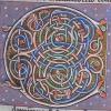 ornamental initial C incorporating dragons