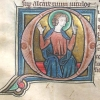 initial Q incorporating a seated nimbed man