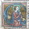 initial C incorporating a seated nimbed man
