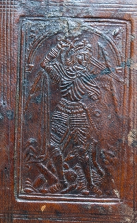 Binding detail showing St Michael slaying the dragon