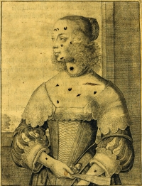 An immodest woman, with patches added by hand.