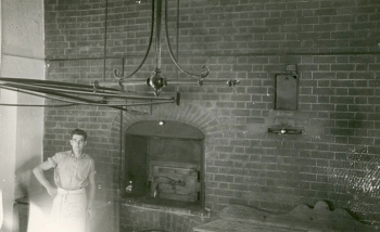 Bill Daish in front of College bakehouse oven by Ken North (1930s)