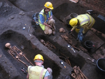 Archaeologists at work. Image credit: Craig Cessford.