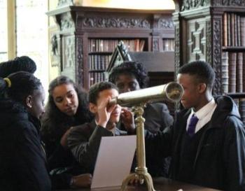 Saint Gabriel's students examine 20th century physicist Fred Hoyle's telescope