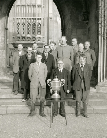 1954 - The College staff gathered behind the Gordon Lennox Cup