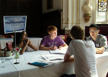 Mathematics students talk to an applicant at a College Open Day