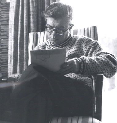 Photograph of Hoyle writing, c. 1965