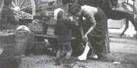 Detail of a woman and child from a street scene photographed by Samuel Butler