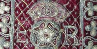 Detail from an embroidered binding, with the initials ER either side of a Tudor rose