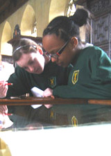 Year 8 students looking at Mercator's Atlas(1613) in the Old Library