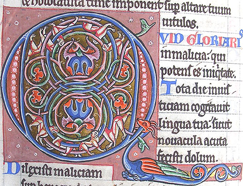ornamental initial Q incorporating cats and a dragon