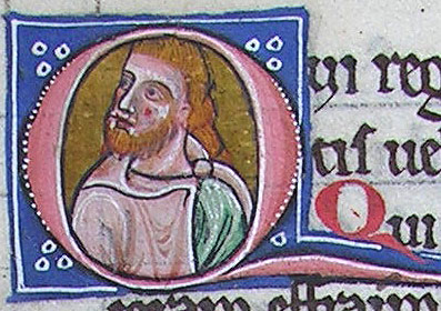 initial Q incorporating the bust of a young bearded man