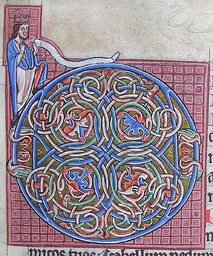ornamental initial D incorporating cats, dragons and a king
