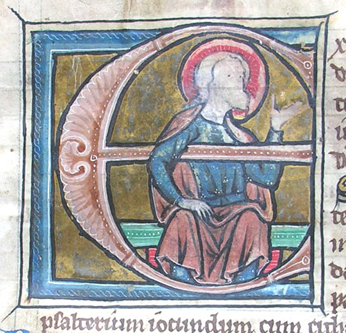initial E incorporating a seated nimbed man