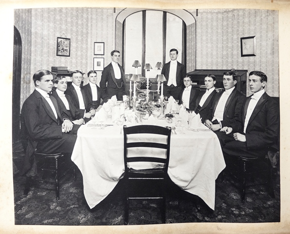 A formal dinner party in a student's room, ca. 1905