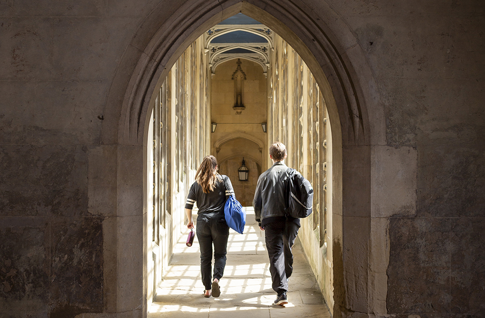 Two students cross the Bridge of Sighs