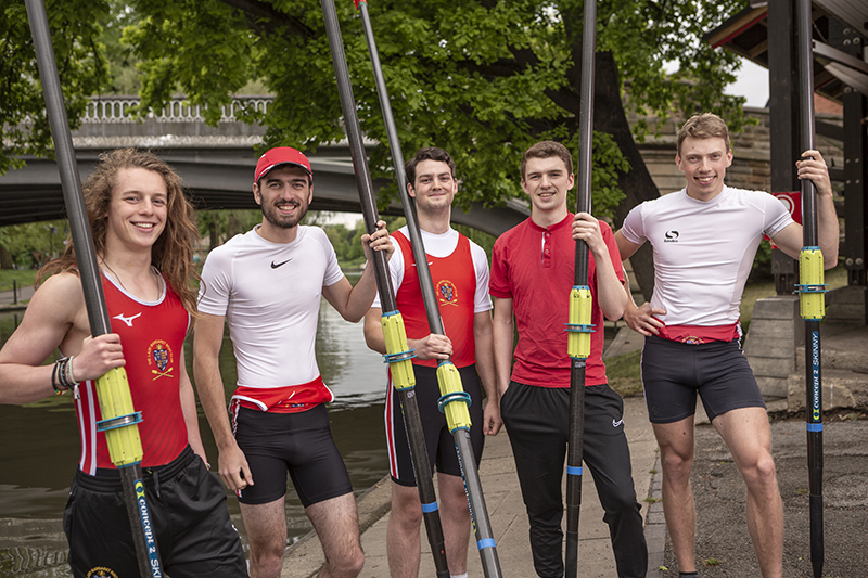 Members of the LMBC men's rowing crews by the River Cam