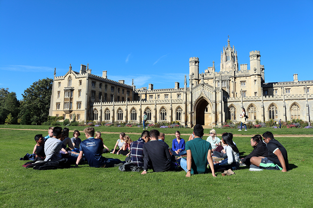 New students having a picnic near New Court