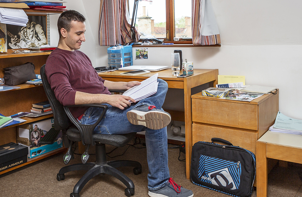 A student studies in his room