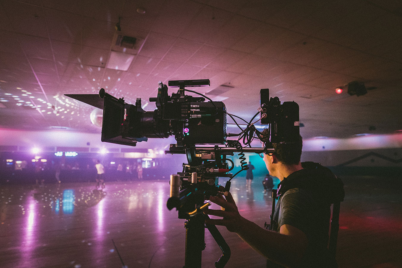 Man films in a roller disco